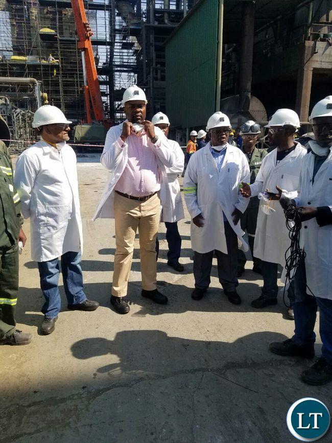 Copperbelt Minister Bowman Lusambo begins the tour of KCM Smelter Plant