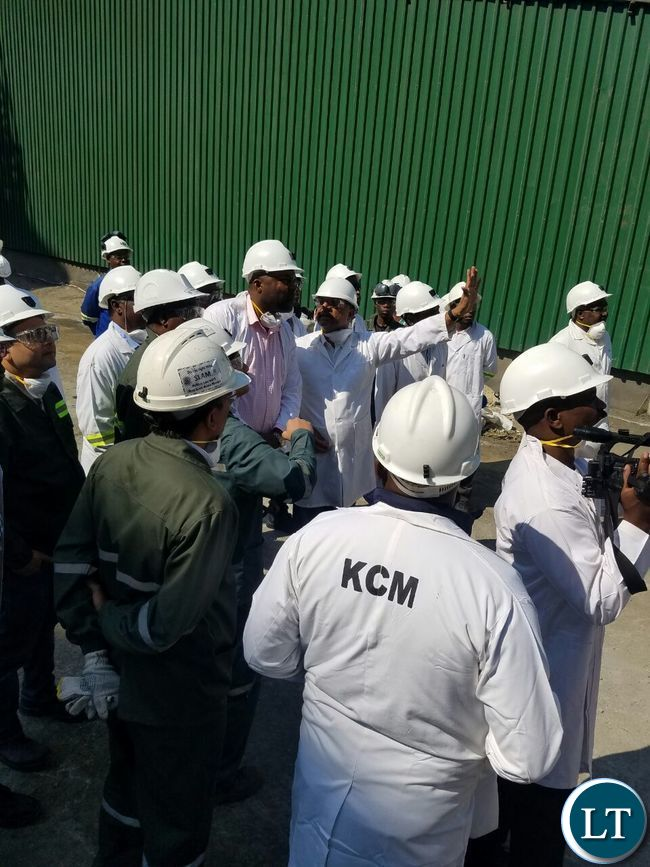 KCM CEO Steven Din stresses a point as he briefs Copperbelt Minister Bowman Lusambo during the tour of the smelter plant