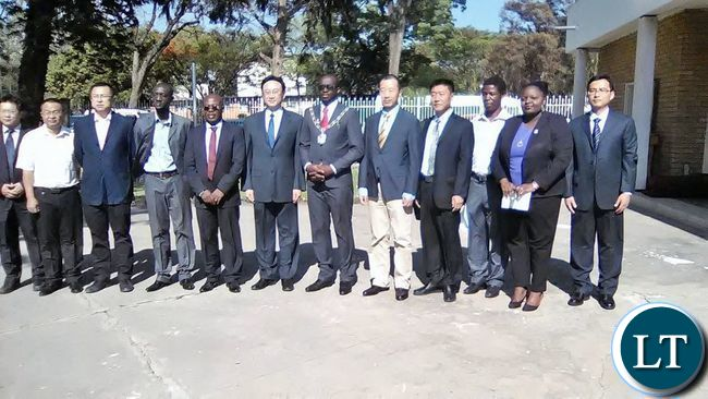 Kitwe Mayor Christopher Kangombe and Visting Shunyi District People's Government of Beijing Municipality Senior Advisor Wang Gang posing for a picture with some delegation members during their visit to Kitwe