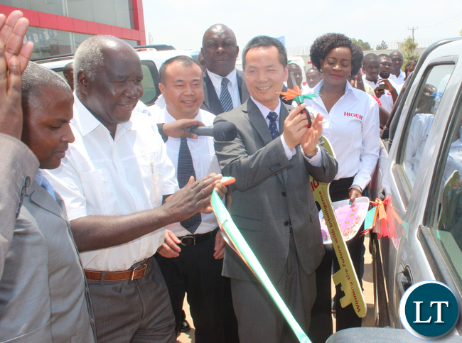 from left to right: Public private drivers association President Josiah Majuru, RDA board member Panji Kaunda, Higer Buses Zambia Ltd General Manager Wu Ming and Guest of Honour Chinese embassy counsellor Out Yang Bin unveiling a van donated to Ministry of Sport, Youth and Child Development.