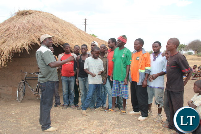 Zesco spokesperson Henry Kapata talking to Luangeni village in Chipata District In Eastern Province against vandalism after electrifying grass thatched houses in the village. A total of 391 thatched houses are being electrified in. Picture by Jean Mandela