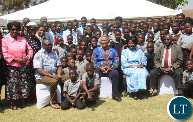 Government officials with members of the Wina family