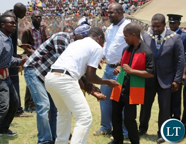 Central province Minister Sydney Mushanga (right) with Kabwe mayor Prince chileshe joins Mukobeko dancing group during this year's independence day celebrations in kabwe.