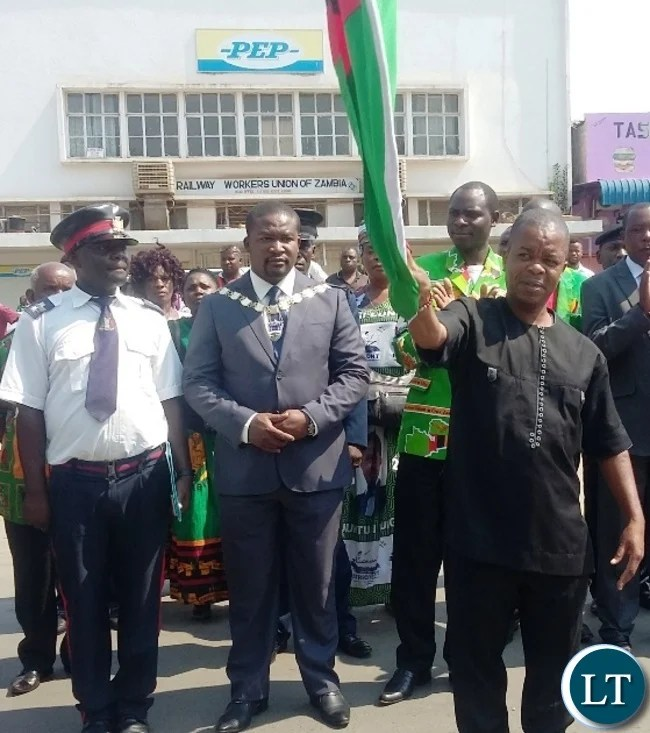 From (right) Central province Minister Sydney Mushanga, Kabwe DC Dominic Mulenga and Kabwe mayor Prince Chileshe flagging of this year's independence celebrations in Kabwe