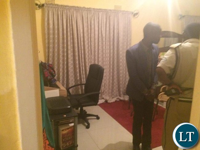 Police officers combing the bedroom