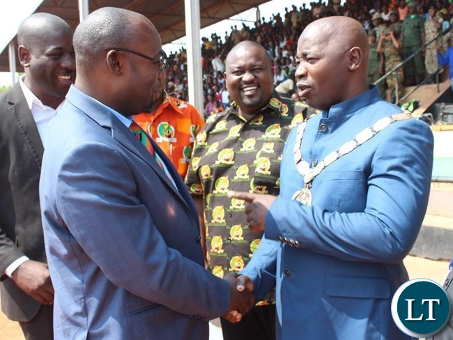CHIPATA Mayor, Sinoya Mwale, talks to Youth, Sport and Child Development Minister, Moses Mawere, after welcoming the Minister at this year's Independence celebrations held at David Kaunda stadium in Chipata. PICTURE BY STEPHEN MUKOBEKO/ZANIS