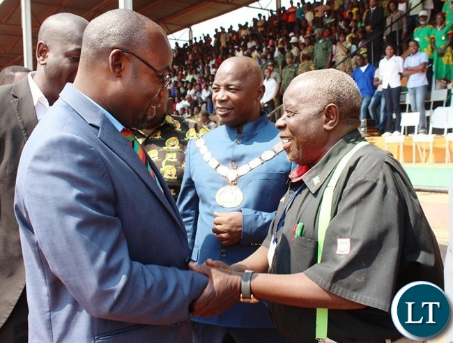 EASTERN Province Freedom Fighters Association of Zambia Chairperson, Frank Banda, welcome Youth, Sport and Child Development Minister, Moses Mawere at this year's Independence celebrations held at David Kaunda stadium in Chipata. PICTURE BY STEPHEN MUKOBEKO/ZANIS