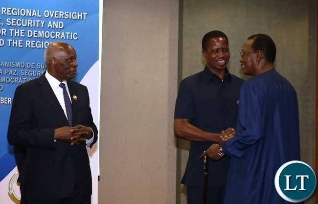 President Lungu confers with Chad President Idriss Deby while Angolan President Eduardo do Santos Looks on during the Great Lakes Summit at vila talatino conference centre in Luanda Angola on 26-10-2016