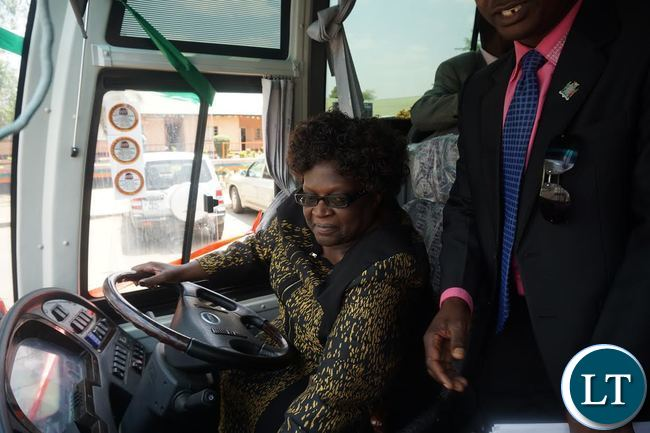 Central Province Permanent Secretary Daisy Ngambi Trying out the 65 seater bus handed over to the Public and Private Drivers Association of Zambia members in Kabwe. Picture By Kelvin Tembo-ZANIS.
