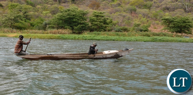 People from Kafue area taking advantage of water transport as crossing the Kafue river to go and witnesses the Paramilitary Pass out Parade