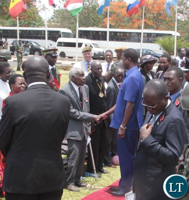President Edgar Lungu shake hand with the War Veteran 94 years old Arron Katongo during the Remembrance Day at the National Cenotaph yesterday 13-11-2016. Picture by ROYD SIBAJENE/ZANIS