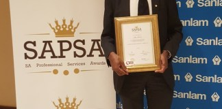 Mr. Kelly Kalumba shows off his certificate after he was nominated as one of the finalists for the Professional of the Year in the 'Architecture Class of the Built Environment' category