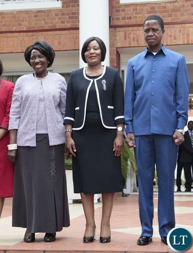 esident Edgar Lungu and Vice President Inonge Wina pose for photo with congratulates Newly appointed Minister of Information Kampamba Mulenga at State House