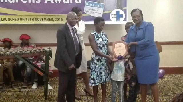 LAZ president Linda Kasonde presenting the Triza Kanyanga childrens award