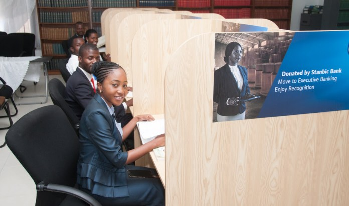 Zambia Institute of Advanced Legal Education (ZIALE) students take advantage of the new study cubicles provided by Stanbic Bank.