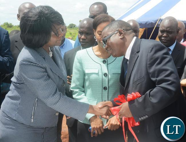 Minister of Commerce,Trade and Industry Margaret Mwanakatwe(l) congratulates  GONOW Zambia Chief Executive Officer Siisii Mukelabai(r) during the Ground Breaking Ceremony for Motor Vehicle Assembly Plant  in Lusaka South Multi Facility Zone