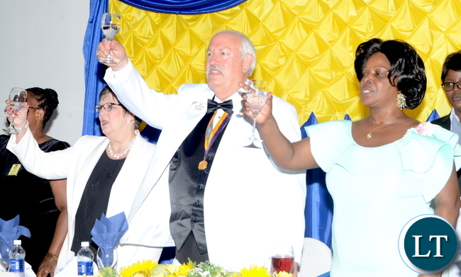 Lions International President Robert Corlew and his wife Diane Corlew being greeted and First Lady Esther Lungu toasts during dinner hosted for him at Pamodzi Hotel in Lusaka on Thursday night, December 15,2016 -Pictures by THOMAS NSAMA