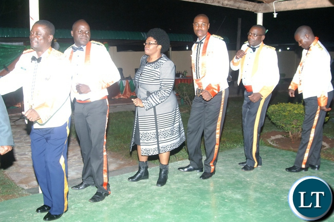 LUAPULA Province Deputy Permanent Secretary Joyce Bwacha Nsamba joins officers to the dancing floor during the Zambia National Service Annual ball at Luamfumu ZNS camp in Mansa