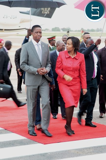 President Edgar Lungu walks abreast South African Minister of International Relations and Cooperation Maite Nkoama- Mashabane after she welcomed him on arrival at the Oliver Tambo International Airport in Pretoria South Africa for a State visit