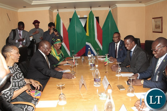 President Edgar Lungu shares a light moment with South African Deputy President cyrill Ramaphosa when he called on him at Sheraton Hotel in Pretoria South Africa