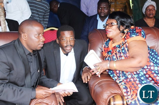 HIGHER Education Minister, Professor Nkandu Luo, Late Mkhondo Lungu's son, Muhabi and Parliament Second Deputy Speaker, Mwimba Malama, confer during the funeral of former Deputy Speaker of the Zambian Parliament, Mkhondo Lungu, at his farm in Lundazi