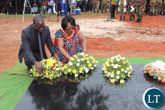 EASTERN Province Minister, Makebi Zulu and Higher Education Minister, Professor Nkandu Luo, lay wreaths at the grave of Mkhondo Lungu at his farm in Lundazi