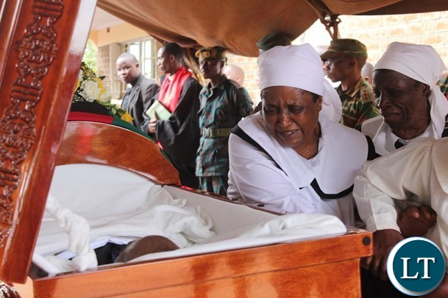 WIDOW of the late Khondo Lungu, pays her last respect to her husband during the funeral of her husband at his house in Lundazi