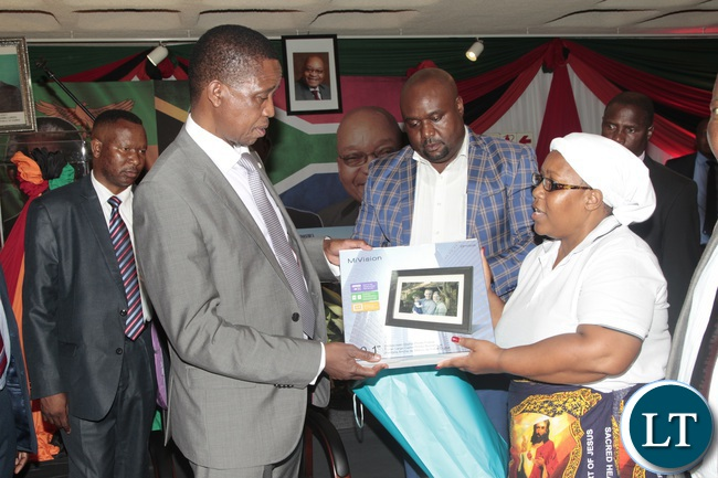 President Edgar Lungu is presented with a digital calendar with memories and pictures of him by Patriotic Front (PF) South Africa branch chairman Mr Sydney Njamba (centre) and his Vice chairperson Rita Zulu (right) during a dinner to meet Zambians living in South Africa held at the Zambian Embassy in Pretoria, South Africa.