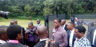 President Edgar Lungu with Livestock and fisheries Minister Michael Katambo inspects some fish ponds during the restocking of fingerlings at the State Lodge Ponds