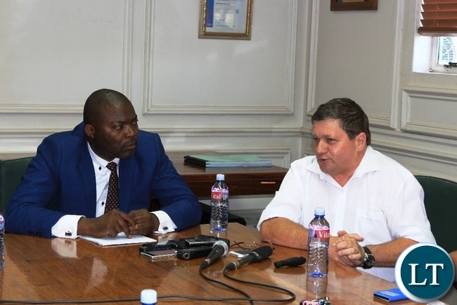 Copperbelt Province Minister, Bowman Lusambo, listens to Mopani Copper Mines Chief Executive Officer, Johan Jansen, in Kitwe