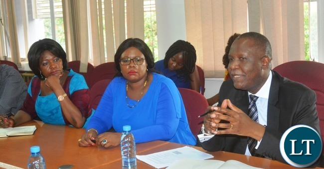 Minister of Finance Felix Mutati(r) flanked with Minister of Agriculture Dora Siliya(c) and Commerce Minster Margaret Mwanakatwe(l) during a Press Briefing at the Ministry of Finance