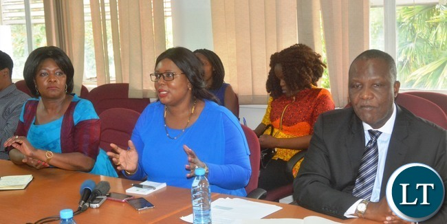 Minister of Agriculture Dora Siliya(c) speaking during a Press Briefing while Minister of Finance Felix Mutati(r) and Commerce Minster Margaret Mwanakatwe(l) looks on at the Ministry of Finance