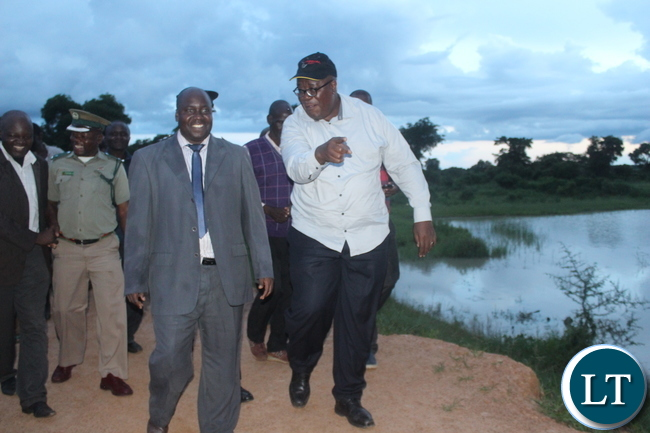 Southern Province Minister Dr Edify Hamukale and the provincial permanent secretary Mr. Sibanze Simuchoba inspecting the Munyenze Dam (right) in Bana Kaili ward of Monze District