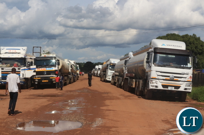 Over 50 Tanker Drivers in Ndola have downed  tools petitioning the Energy Regulations Board (ERB) though the Ministry of Energy to put up a Statutory of Instrument to stop foreign tanker Drivers from getting fuel from the sources up  the final consumer, a situation they described is disadvantaging them. PICTURES BY FRANK CHING'AMBU/ZANIS