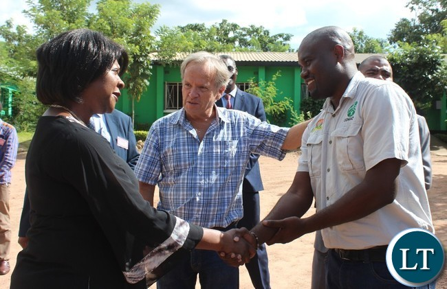 COMMUNITY Market for Conservation (COMACO) President and founder, Dale Lewis, introduces COMACO Manager, Smith Kapeya, when the Minister visited COMACO in Chipata on Thursday. PICTURE BY STEPHEN MUKOBEKO/ZANIS