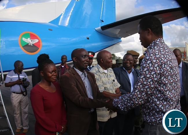 PRESIDENT Edgar Lungu shake hands with Luapula Province Minister Nickson Chilangwa at Mansa airport shortly before his departure for Lusaka. This was after concluding his tour of the Province on Saturday.