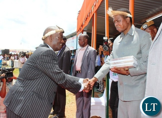 PROFESSOR Yizenge Chondoka, shakes hands with President Edgar Lungu after presenting books entitled ' The Zwangendaba Mpezeni Ngoni '  which he authored. This was at this year's Ncwala ceremony in Chipata. PICTURE BY STEPHEN MUKOBEKO/ZANIS