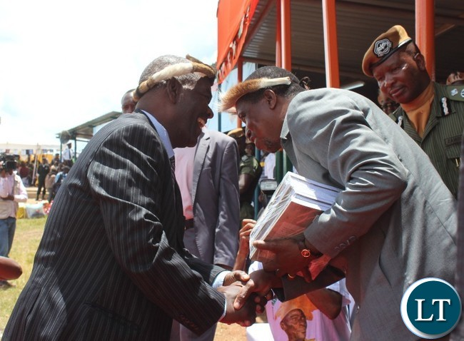 PROFESSOR Yizenge Chondoka talks to President Edgar Lungu after he presented books entitled ' The Zwangendaba Mpezeni Ngoni '  which he authored. This was at this year's Ncwala ceremony in Chipata. PICTURE BY STEPHEN MUKOBEKO/ZANIS