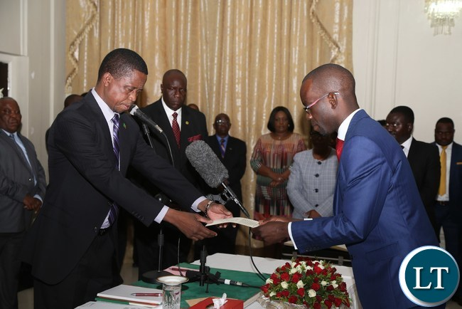 President Edgar Lungu receives an affidavit of Oaths from newly appointed Copperbelt Province Permanent Secretary Elias Kamanga during the Swearing in Ceremony at State House yesterday-PICTURE BY KACHA MIYOBA/ZANIS