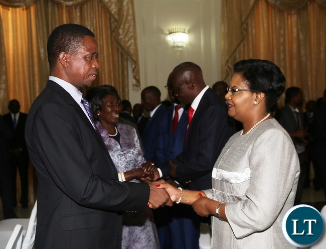 President Edgar Lungu receives an affidavit of Oath from newly appointed Permanent Secretary in the Ministry of Tourism and Arts Dr.Liya Mutale during the Swearing in Ceremony at State House