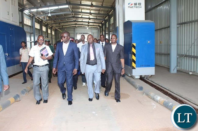 EASTERN Province Minister, Makebi Zulu (second left) being led by Zambia Revenue Authority (ZRA) Chanida border post Acting Station Manager, Peter Nyirenda (far left) during the inspection of the ZRA Scanner at the border on Tuesday. On the right are Chadiza District Commissioner, George Phiri and Eastern Province Assistant Secretary, Royd Tembo. PICTURE BY STEPHEN MUKOBEKO/ZANIS