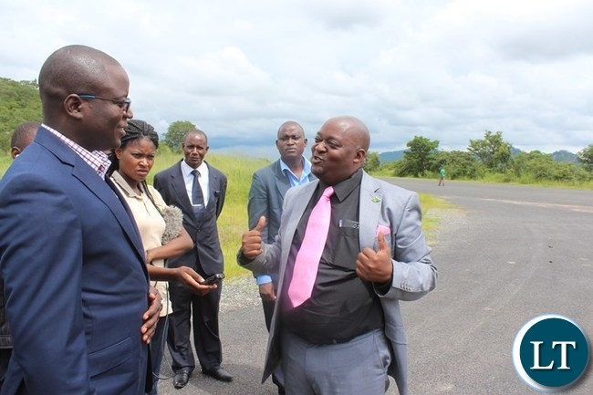 CHADIZA District Commissioner, George Phiri, explains to Eastern Province Minister, Makebi Zulu, when he inspected township roads in the district on Tuesday. PICTURE BY STEPHEN MUKOBEKO/ZANIS