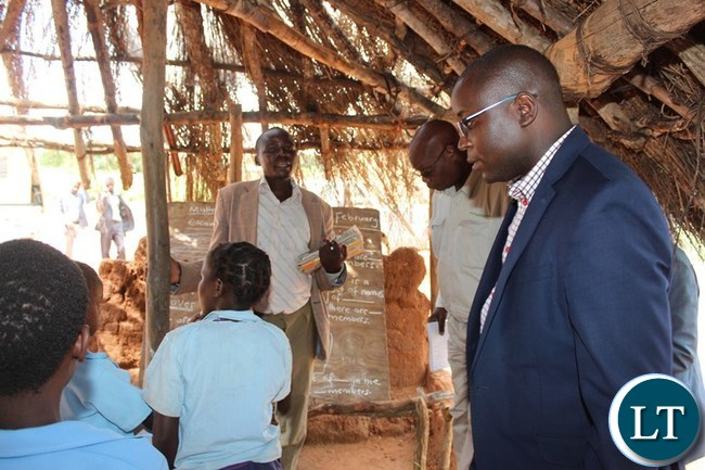 EASTERN Province Minister, Makebi Zulu, inspects a 'Classroom' at Mwangala Primary School which was started in 2006 in Chief Mwangala's area in Chadiza on Tuesday. The school has not seen any improvement in terms of structures since then. In the middle is school Head Teacher, Patrick Tembo and second left is Eastern Province Education Officer, Allan Limgambe. PICTURE BY STEPHEN MUKOBEKO/ZANIS