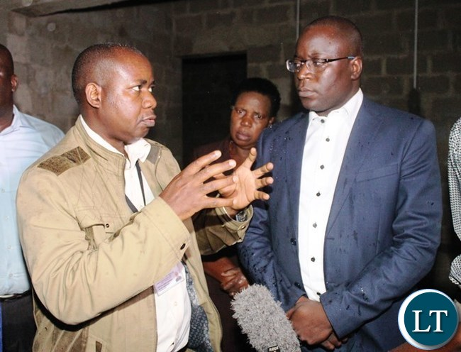 EASTERN Province Acting Medical Officer, Jairos Mulambya, explains to Eastern Province Minister, Makebi Zulu, when he inspected Vubwi District hospital which is under construction. PICTURE BY STEPHEN MUKOBEKO/ZANIS