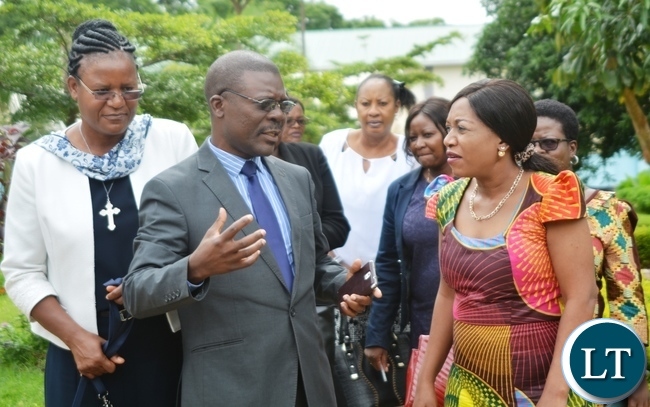 St Mary's  Secondary School  Head Teacher  Agness  Zimba (L) and Parent Teachers Association (PTA)Manager  Stein Mukadawile(C) with Minister of Gender Victoria Kalima(r)  during the Ministers Visit to the School