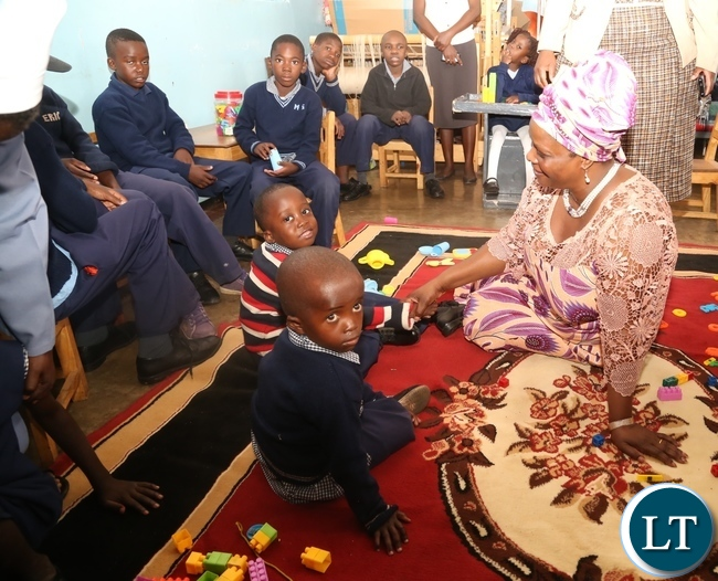First Lady Esther Lungu(in chitenge suit) having a light moment with Disabled children as she visited Zambia Institute of Special Education in Lusaka yesterday,3-3-2017, Picture by Ennie Kishiki/Zanis.