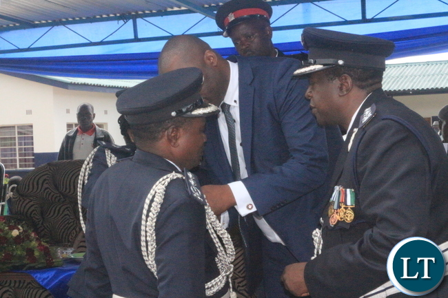 Copperbelt Minister, Bowman Lusambo unveiling medals given to deserving Police Officers during 'Police Day' at Kamfinsa School of Meintenance in Kitwe