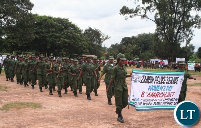 Women from Zambia Police service marching during the commemoration of International Women Day at Youth Grounds in Solwezi on Wednesday. PICTURE BY BETRAM KAOMA /ZANIS