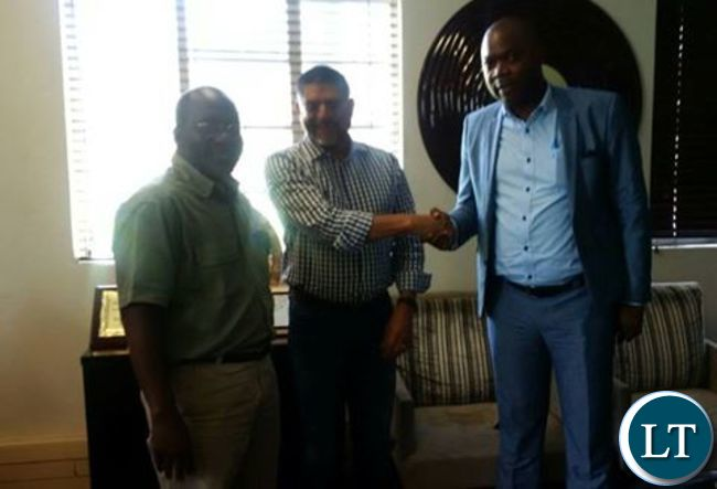 KCM CEO Stevin Din shakes hands with Copperbelt Minister Bowman Lusambo after donating 20,000 AFCON match ticekts