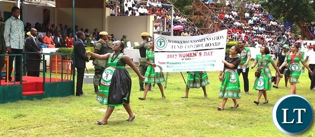 President Edgar Lungu (far left) watching marchers during this year's international women's day commemorations held in the show grounds in Lusaka. Picture by SUNDAY BWALYA/ ZANIS